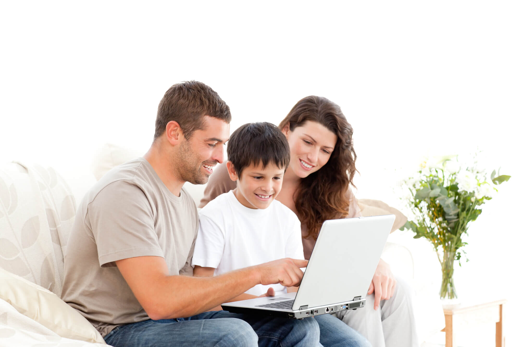 mom dad and son looking at a laptop
