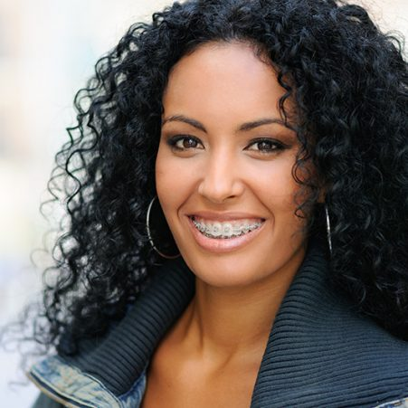 curly-haired-woman-smiling