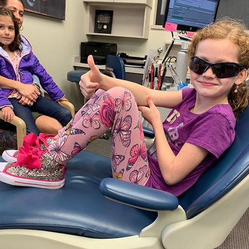 pic_of_cute_7_year_old_redhead_in_ortho_chair_C